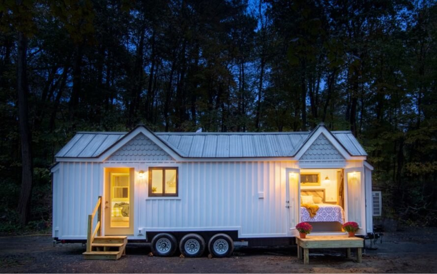 white tiny farmhouse on wheels