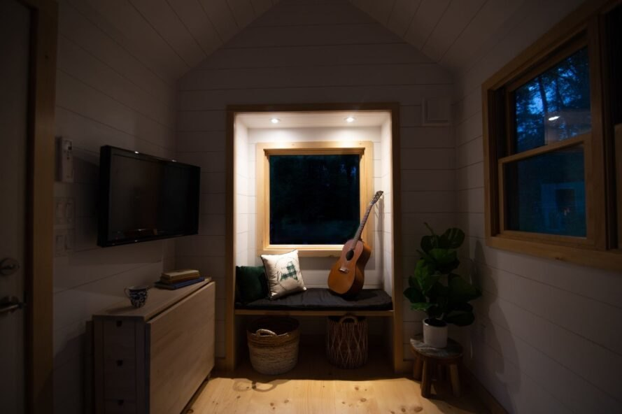 white tiny home interior with dim lights at night