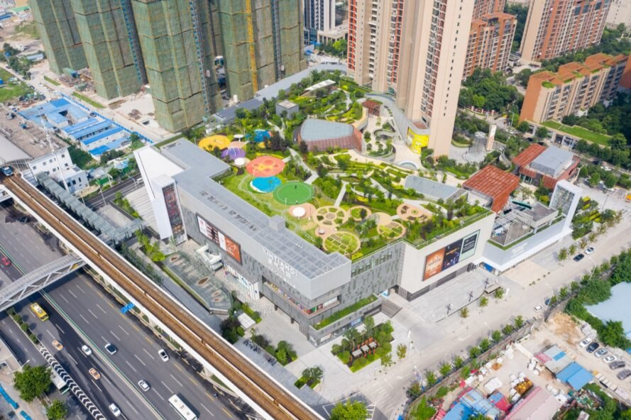 aerial view of park and green space on top of a mall building