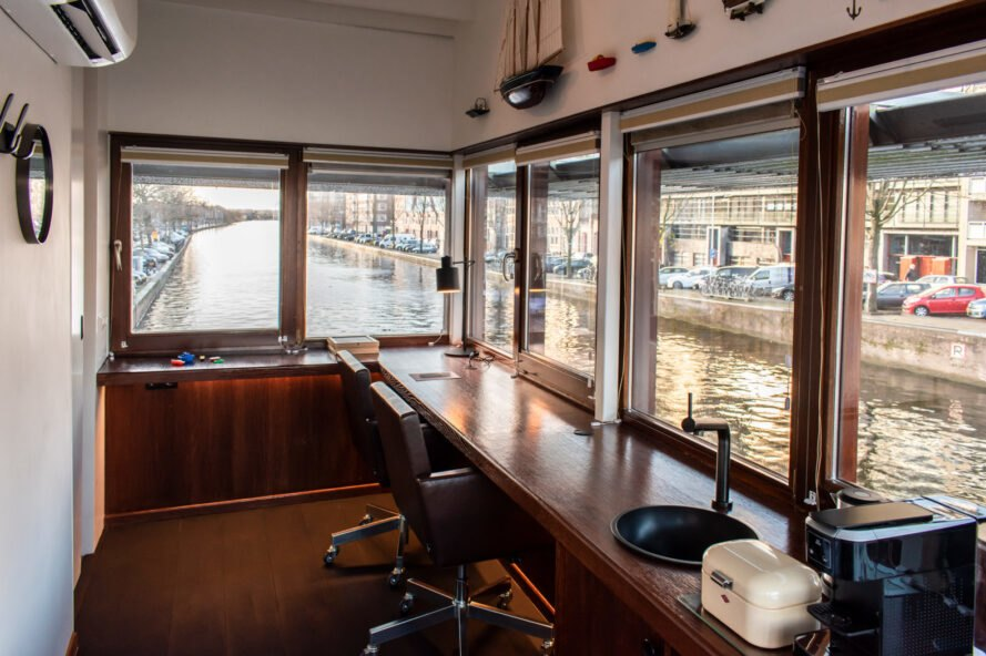 dark wood desk with views over Amsterdam canal