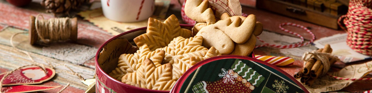 sugar cookies inside a Christmas tin