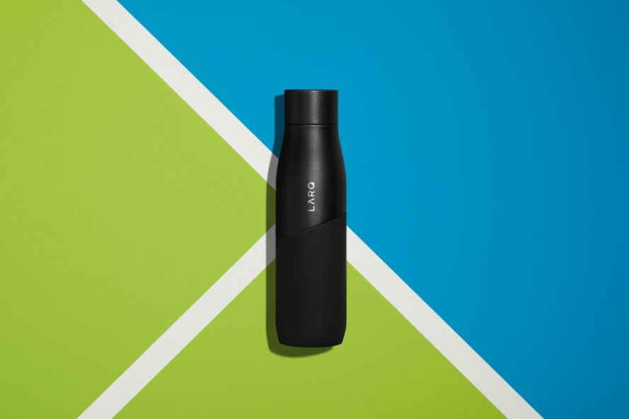 black water bottle on blue and green background