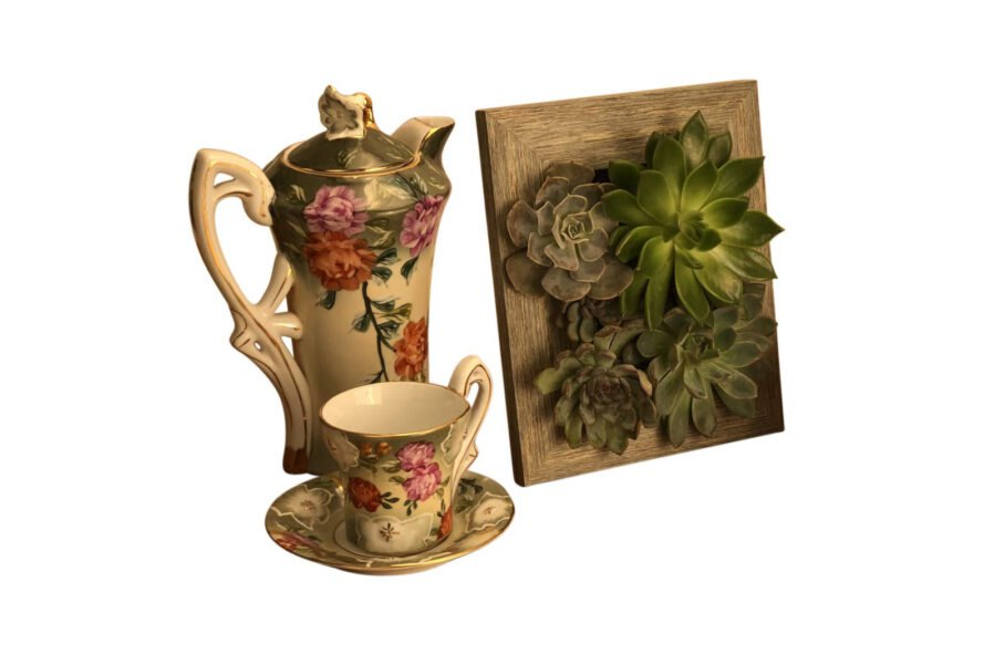 picture frame with succulents next to vintage tea set