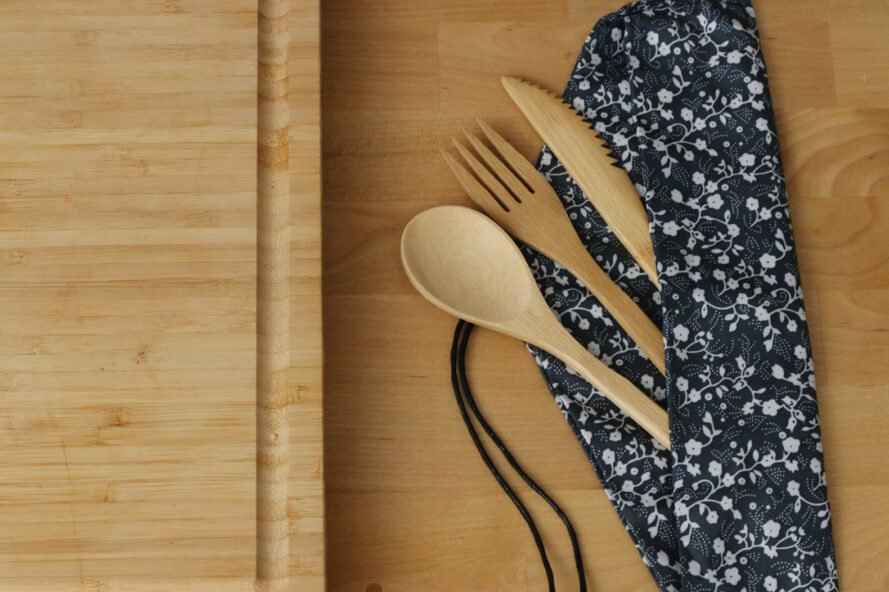bamboo utensils on wood background