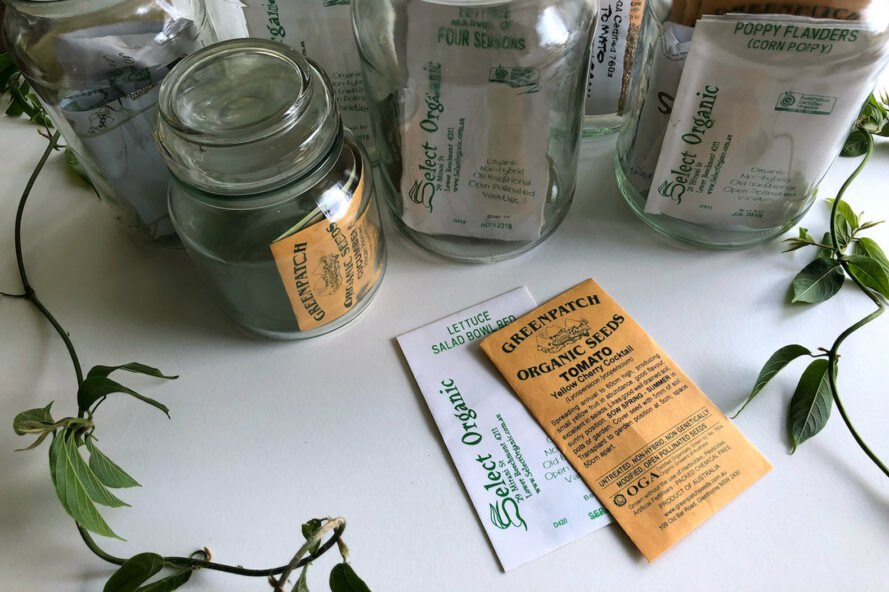 organic seed packets in glass jars