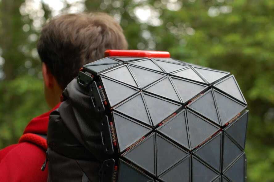 triangular solar panels attached to a backpack