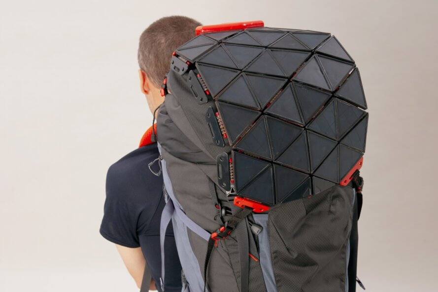 person wearing backpack with solar panels