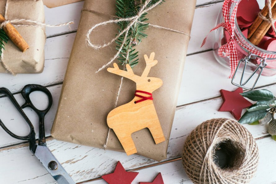 natural brown wrapping paper, twine and wooden reindeer ornament