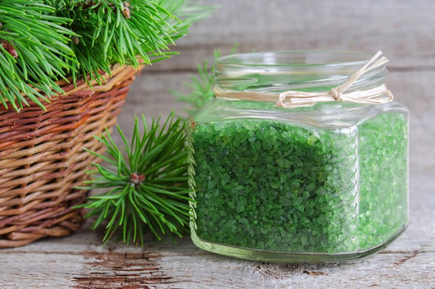 Sea bath salt with pine extract in a glass jar