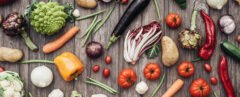 fruits and vegetables on a wood background
