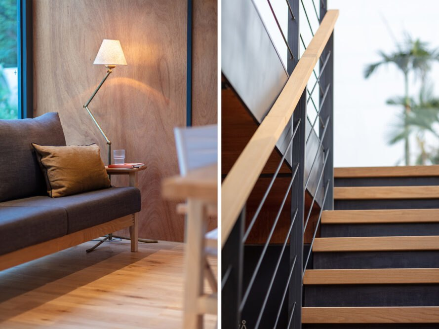 the photo to the left showcases a sofa against a floor-to-ceiling window with a sofa next to it and a lamp. the photo to the right is a set of stairs leading up to a second floor