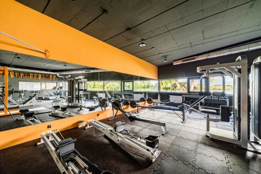 gym equipment in room with yellow walls