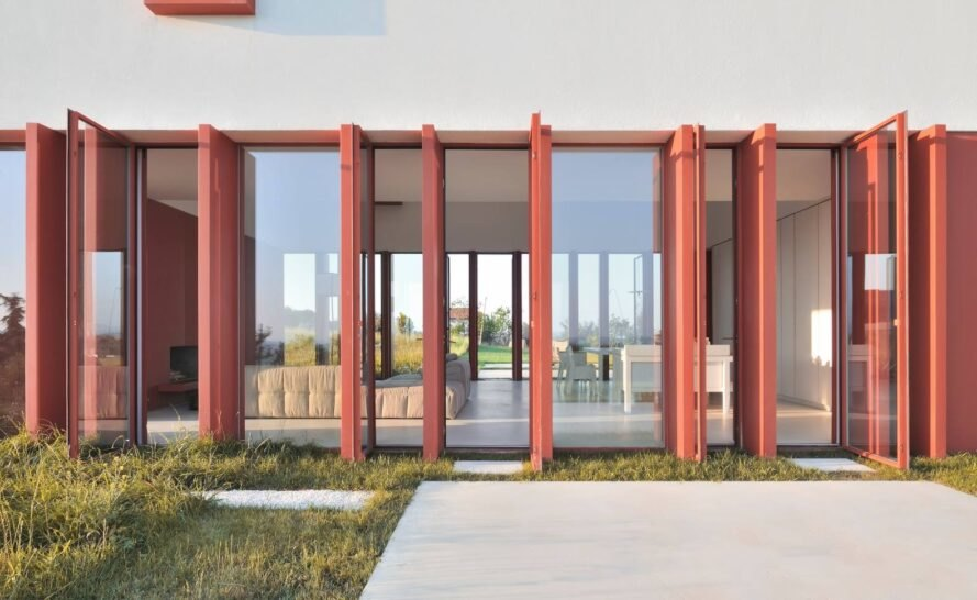 red-framed glass doors opening to patio