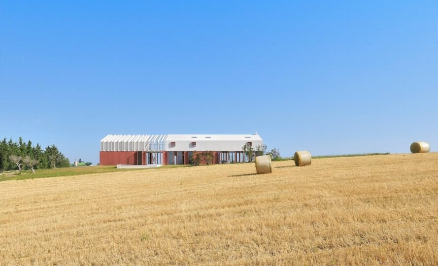 elongated barn-inspired home with open slatted roof