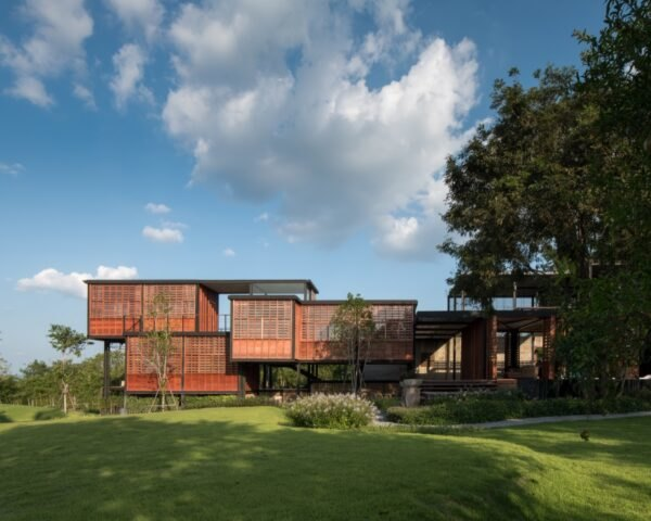 long brown home elevated off the land