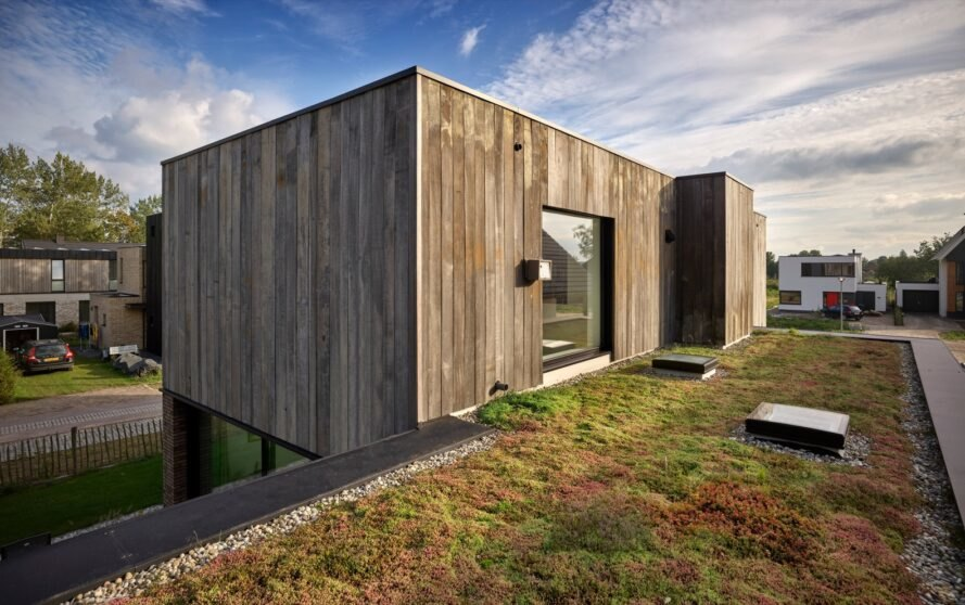 green roof leading to glass door of upper floor of a home