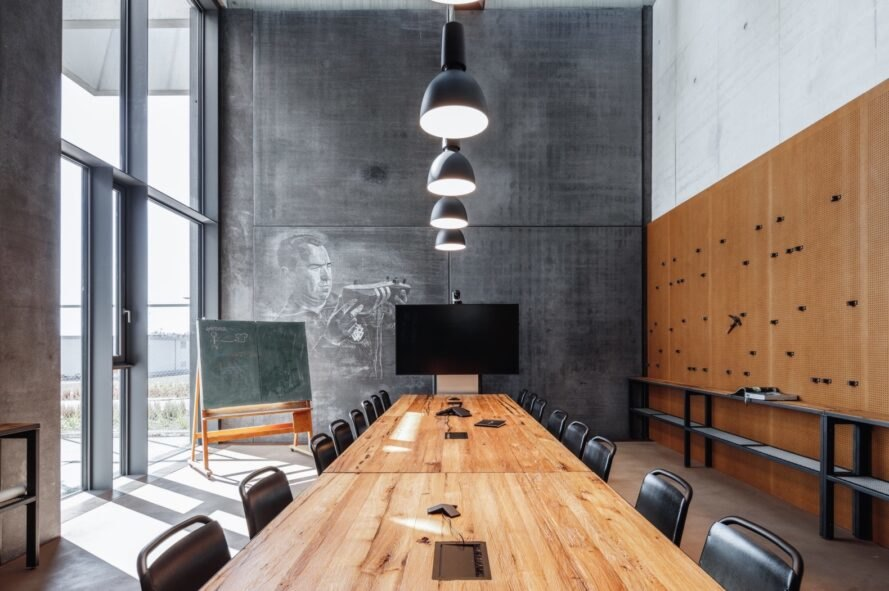 meeting room with wall mural, small chalkboard and long wood table