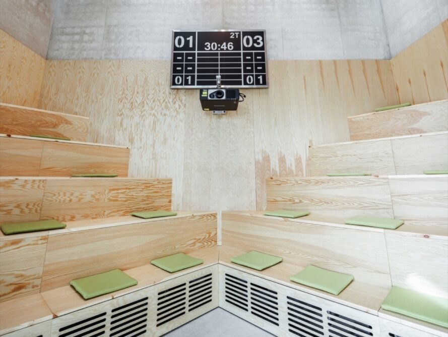 wood room with stacked benches and a scoreboard
