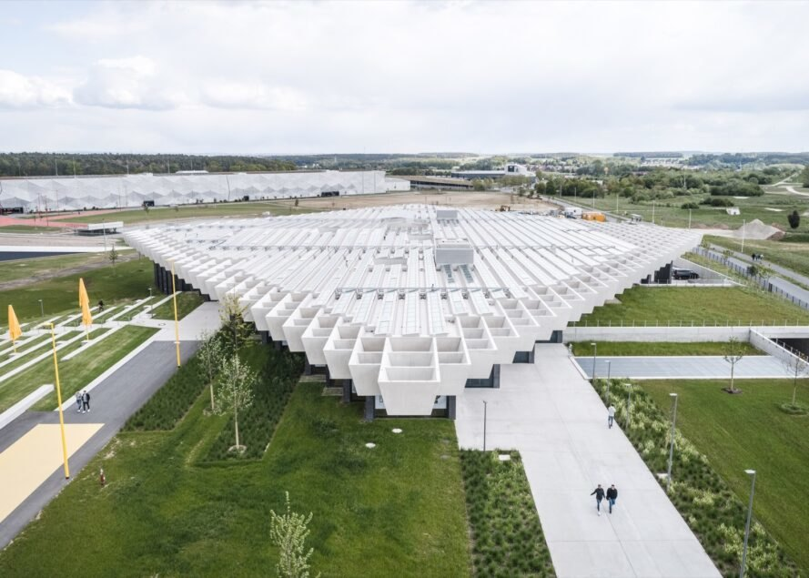 aerial view of glass building with white rhomboid roof