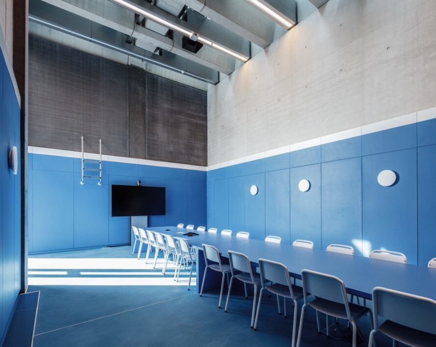 meeting room with blue walls and long rectangular table