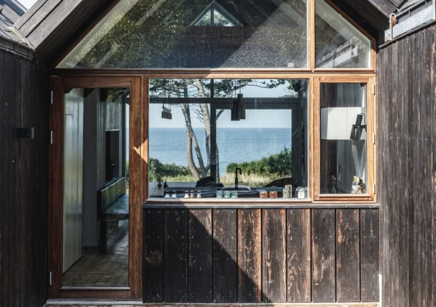 cabin with windows revealing views of the sea