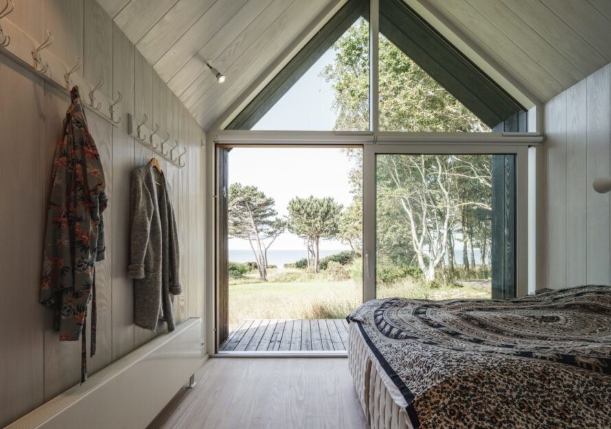 bedroom with floor-to-ceiling glass facade