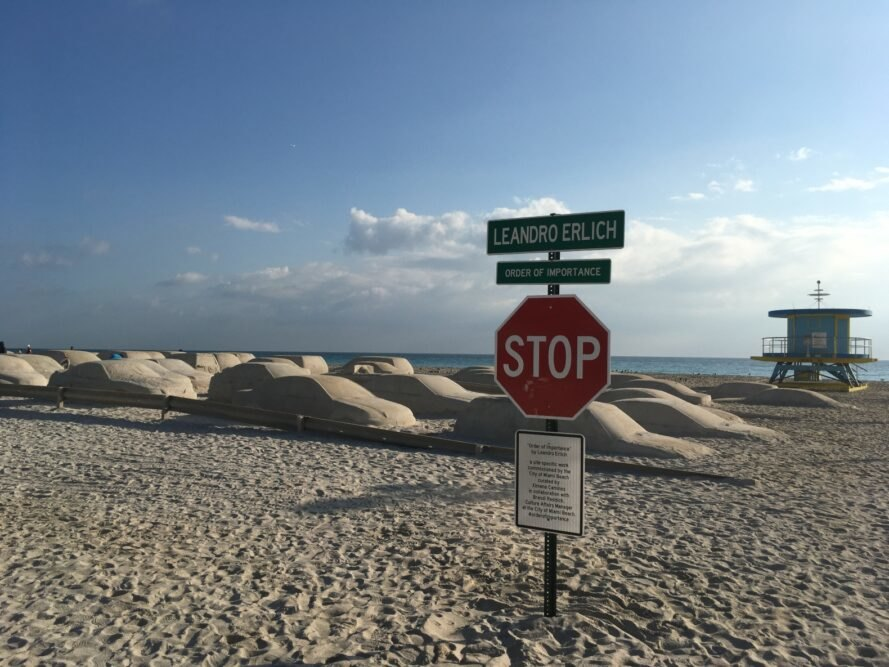 stop sign on beach with 66 sand cars