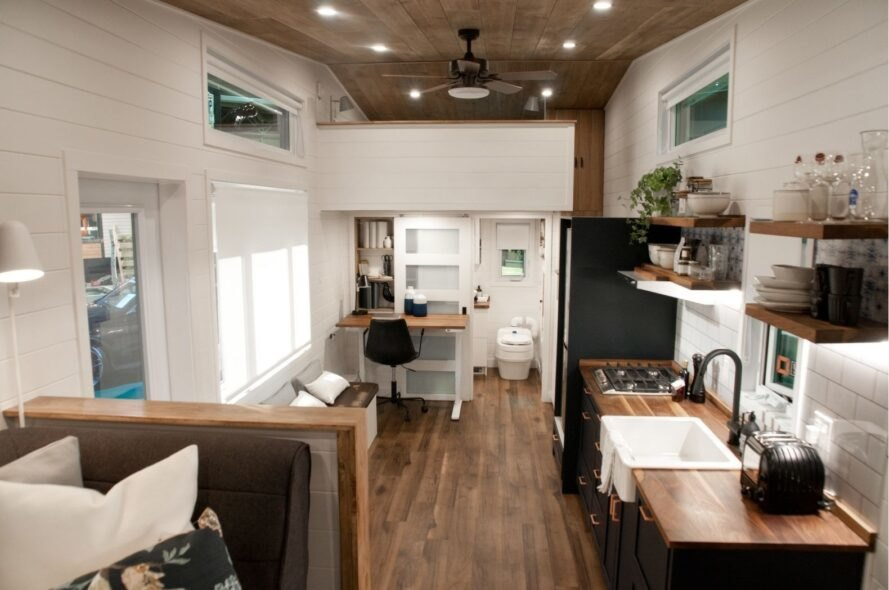 tiny home with white walls, dark wood floors and dark wood ceilings