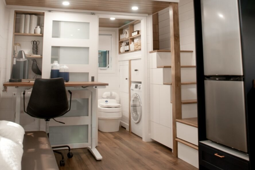 interior area of tiny home with steps leading to sleeping loft