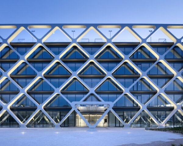 glass building with white, latticed facade