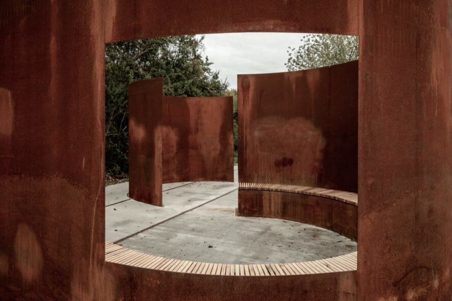 weathered steel sculptures with inbuilt benches