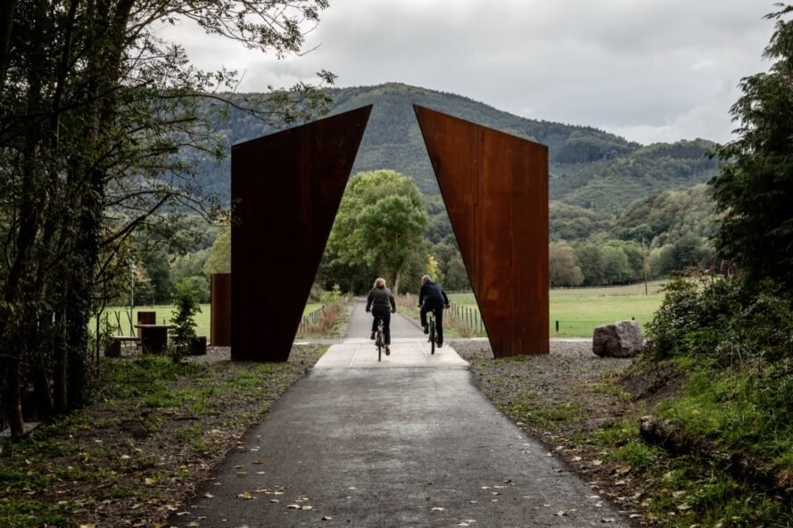two angular weathered steel sculptures in a park