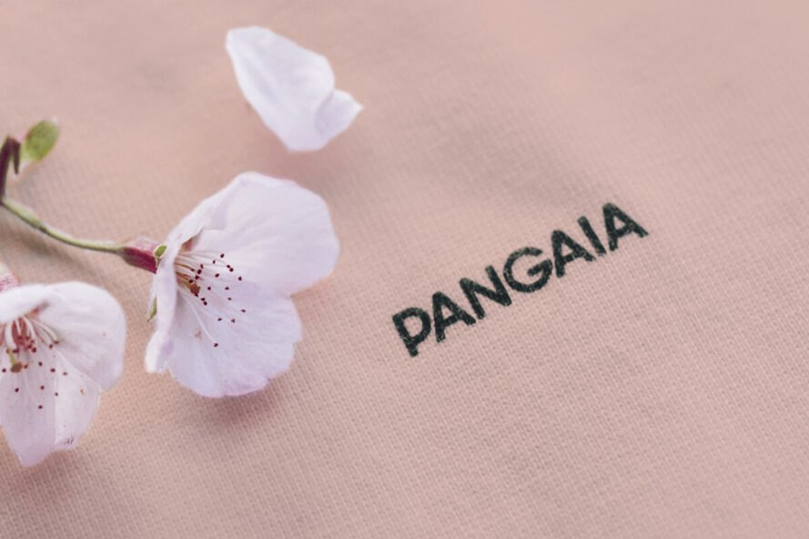 "cherry blossom on a pink shirt that reads, ""Pangaia"""