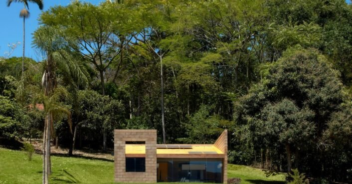 Minimalist home in the Brazilian countryside is made from mining waste
