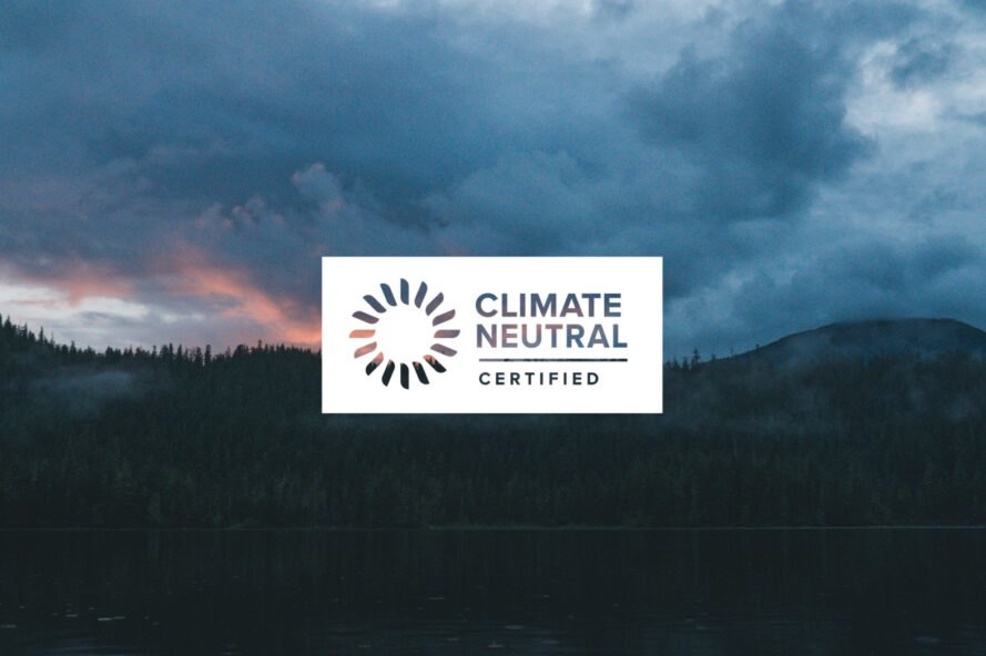 White Climate Neutral Certification logo on a mountainous background