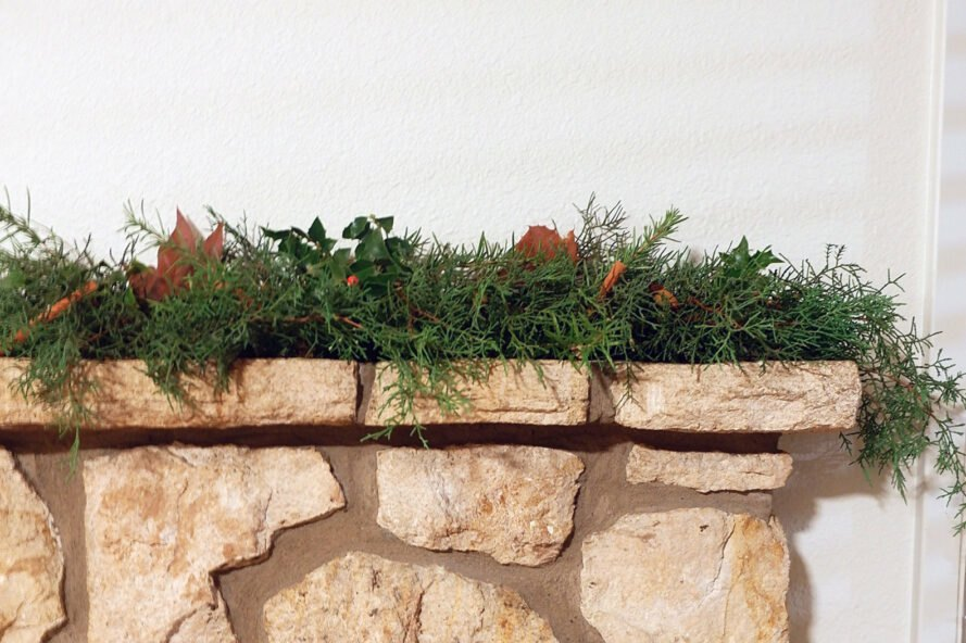 garland of evergreens on a stone fireplace
