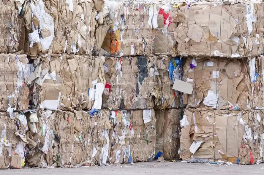 paper pulp compressed into blocks at a recycling plant