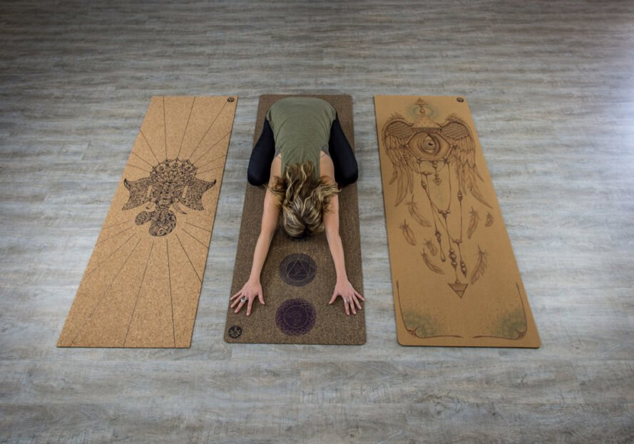 person doing yoga on a cork mat