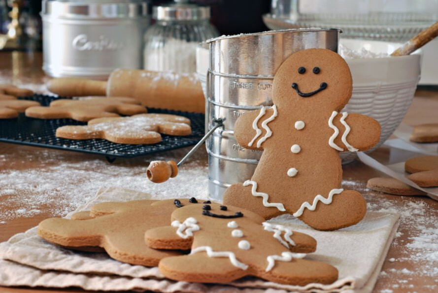 decorated gingerbread men on a kitchen counter