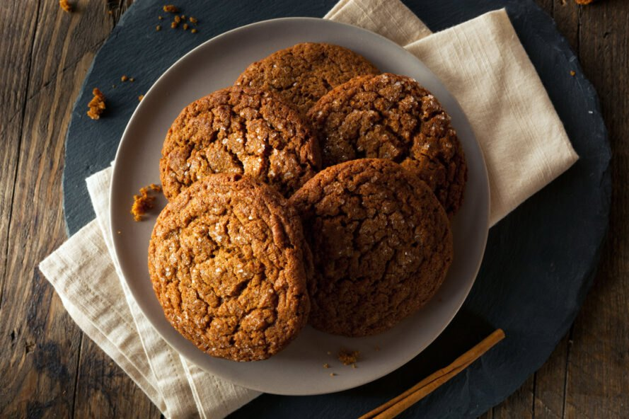 pile of molasses cookies on a plate