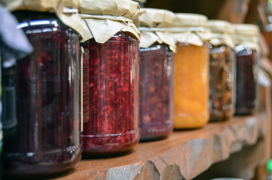colorful jams in glass jars