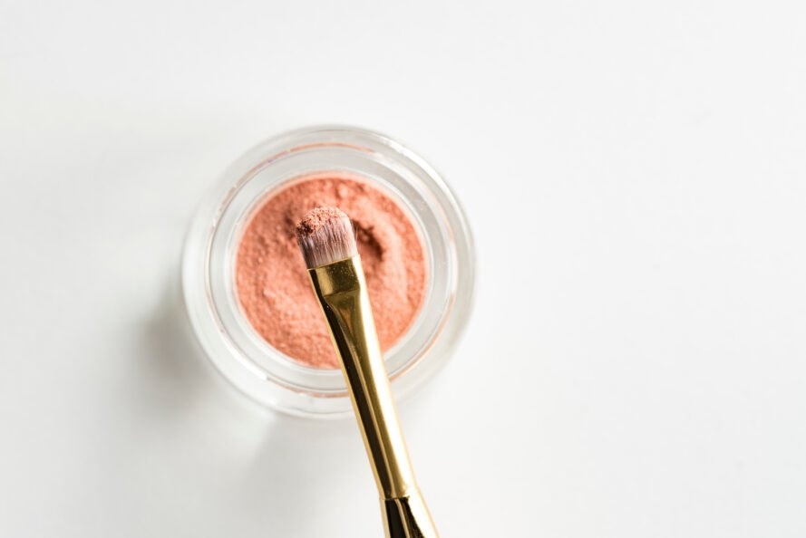 pink makeup in glass jar