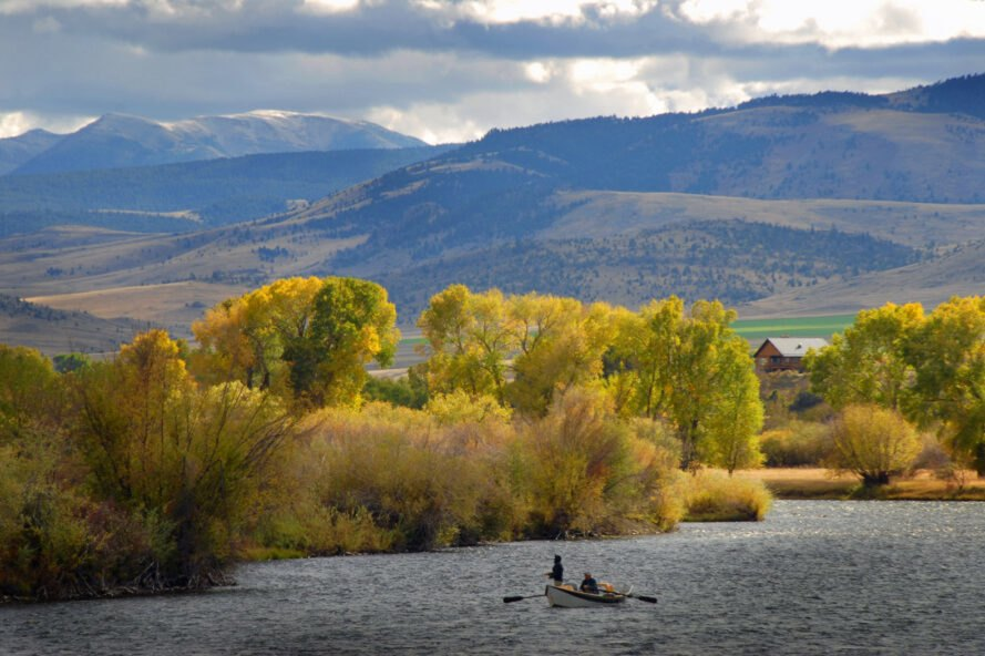 people in boat on lake fly-fishing