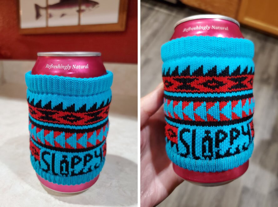 aluminum can wrapped in a blue cloth reusable cup sleeve