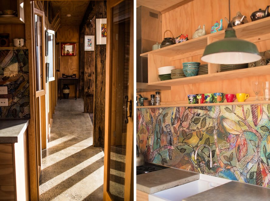 On the left, narrow hallway in wood home. On the right, kitchen with colorful backsplash and wood cabinets