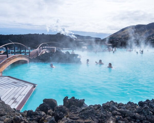 people swimming in Blue Lagoon natural hot springs