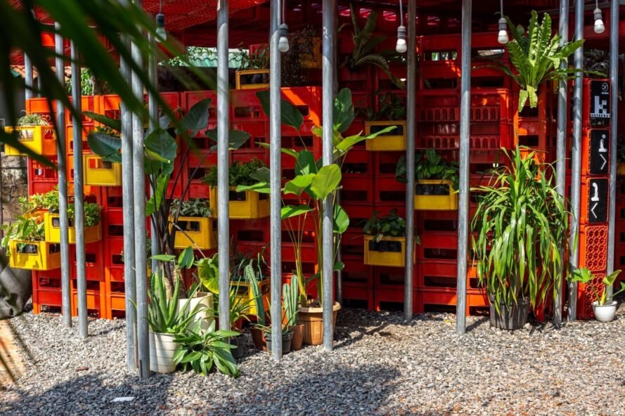 walls of plastic crates with plants