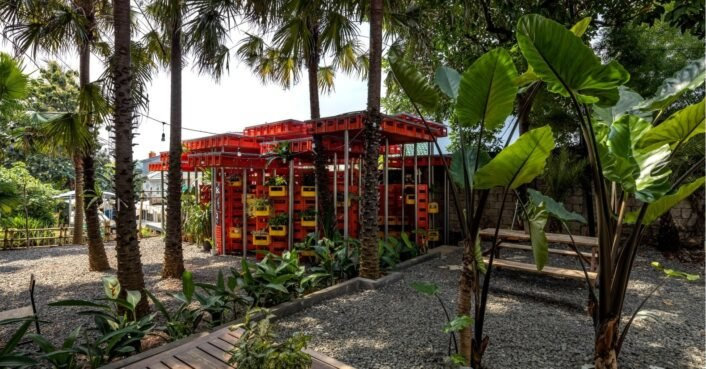 Hundreds of red plastic crates are repurposed into a public mosque in Indonesia