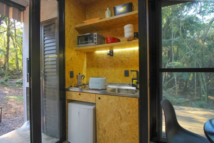 small kitchenette with refrigerator and sink