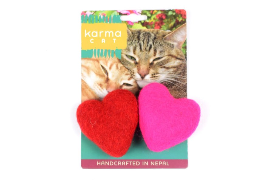 a Karma Cat toy package with two felt hearts, one red and one pink. the packaging features two cats (one gray speckled and one orange) leaning against each other